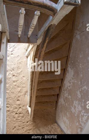 Africa, Namibia, Luderitz. Kolmanskop, former diamond mining town abandoned in 1940. Sand filled room reclaimed - Stock Photo