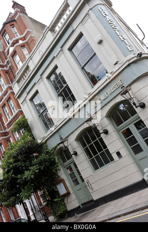 Extreme angled aspect of the very popular Chelsea haunt Cheyne Walk Brasserie,just a stones throw from the River - Stock Photo