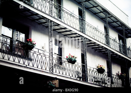 The Spanish-style architecture of the French Quarter of New Orleans, Louisiana dates back hundreds of years to the - Stock Photo