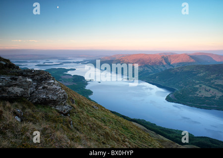 Daybreak on Loch Lomond and the Luss mountains from near the summit of Ben Lomond in the southern highlands of Scotland - Stock Photo