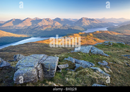Daybreak on Loch Lomond and the Arrochar Alps from near the summit of Ben Lomond in the southern highlands of Scotland - Stock Photo