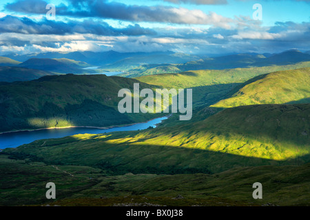 Daybreak on Loch Katrine and the Arrochar Alps from the summit of Ben Ledi in the southern highlands of Scotland - Stock Photo