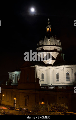 Cathedral church dome under full moon, photographed at night with top tower lit, Altoona, PA, USA. - Stock Photo