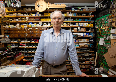 Michael Read 62, serving in Gills in Oxford the country's oldest hardware store - Stock Photo