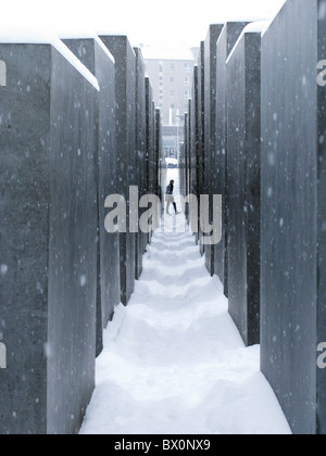View of the Holocaust Memorial in winter with snow in Berlin, Germany - Stock Photo