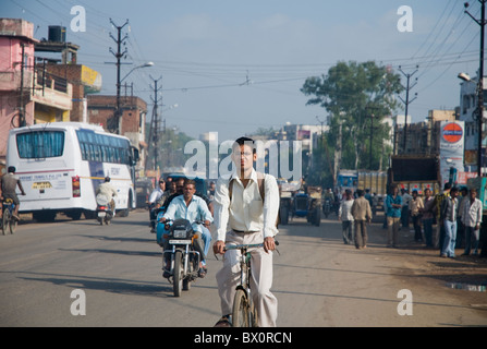 Cyclists on the streets of Bhopal in India - Stock Photo