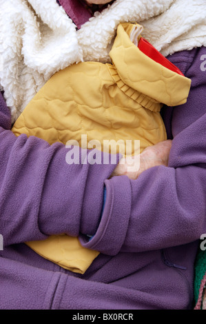 Elderly Woman Keeping Warm In Winter Wrapped Up With A