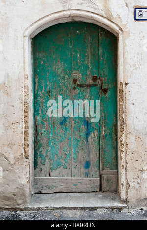 House door in Gallipoli's old town, Puglia, Italy - Stock Photo