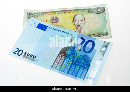 Vietnamese 1000 Dong note with a 20 Euro note - Stock Photo