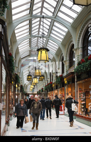 Royal Arcade, Norwich, Norfolk, England, UK. Shoppers in glass covered Victorian shopping precinct with traditional - Stock Photo
