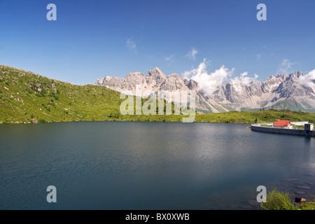 summer view of lake Cavia near San Pellegrino pass, Trentino, Italy - Stock Photo