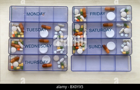 Daily pill dispenser - Stock Photo