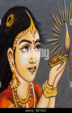 Traditional Indian painting of a Indian woman holding an oil lamp. Andhra Pradesh, India - Stock Photo
