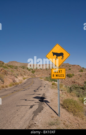 Watch for donkeys signs dot old Route 66 on entrance to the ghost town of Oatman, Arizona, USA - Stock Photo