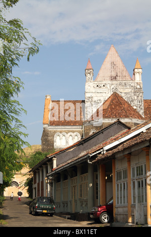 Old houses and street with backdrop of an old church at the Dutch Fort, Galle, Sri Lanka. - Stock Photo