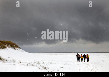 Winter time, people at the beach, hiking. North sea island Spiekeroog, east Frisian Island at the north west coast - Stock Photo