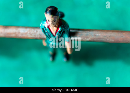 Table football player in turquoise shirt. - Stock Photo