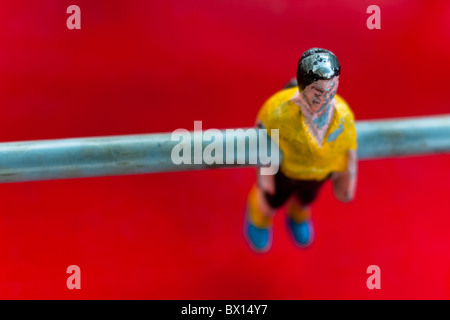 Table football player in yellow shirt. - Stock Photo