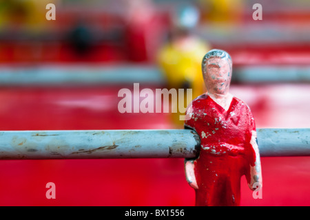 Table football player in red shirt. - Stock Photo