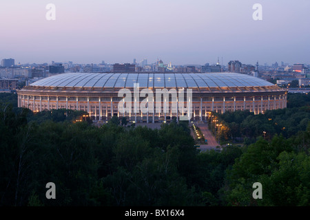 Luzhniki Stadium (chief venue for the 1980 Summer Olympics) at dusk in Moscow, Russia - Stock Photo