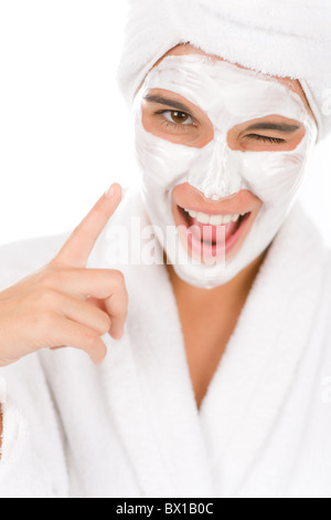 Teenager facial mask - happy woman on white background - Stock Photo