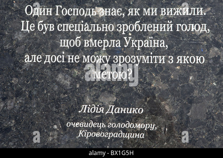 Statement of a 1932-1933 famine victim on a stone plate outside the Holodomor Monument and Museum in Kiev, Ukraine - Stock Photo