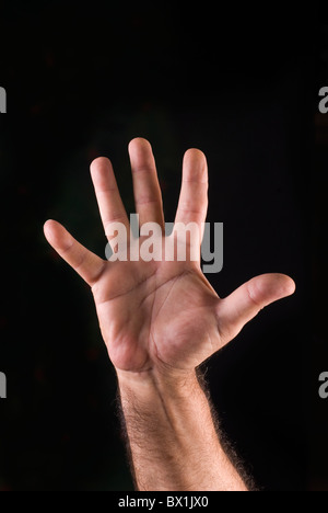 Hand of man showing a stop gesture - Stock Photo