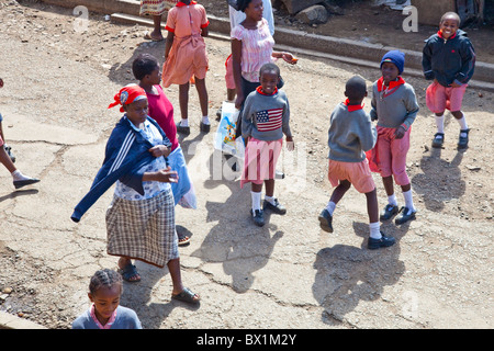 Little girl wearing american flag sweater in the Mathare slums, Nairobi, Kenya - Stock Photo
