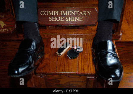 black brush care clean cream customer Hotel leather shoes polish services shoes clean shoeshine boys - Stock Photo