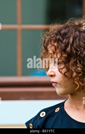 Serious little girl profile looking away Beirut Lebanon Middle East Asia - Stock Photo