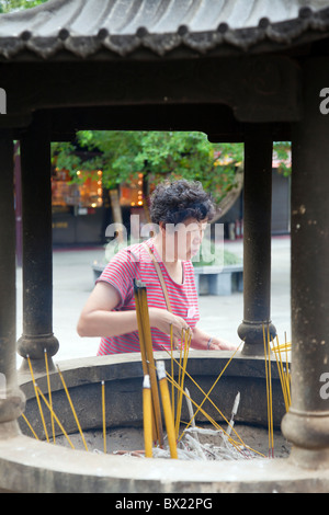 Incense burning at the entrance to Po Lin Monastery - Stock Photo