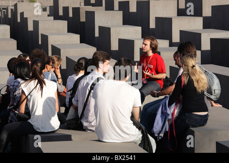 traveling group with young people at the Memorial to the Murdered Jews of Europe in Berlin, Germany - Stock Photo