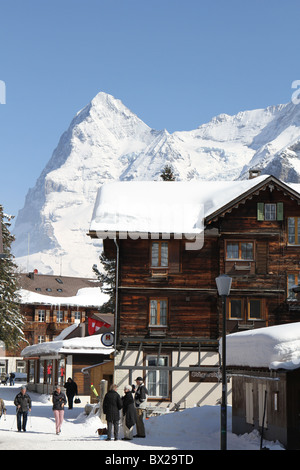Murren, Switzerland - Main Street through the town with a stunning view of the Eiger mountain - Stock Photo