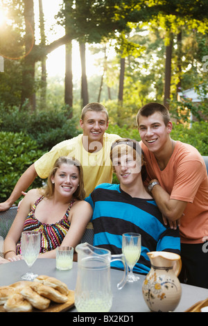Friends hanging out together drinking lemonade - Stock Photo