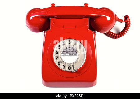 Photo of a retro red telephone isolated on a white background. - Stock Photo