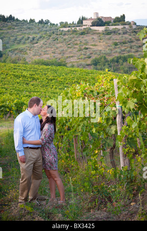 Couple kissing in a vineyard underneath Greve in Chianti Italy - Stock Photo