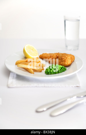 fish, chips and peas - Stock Photo