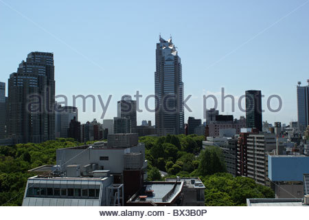 The Park Hyatt and Tokyo Metropolitan Government buildings tower over Tochomae park in Shinjuku, Tokyo. - Stock Photo
