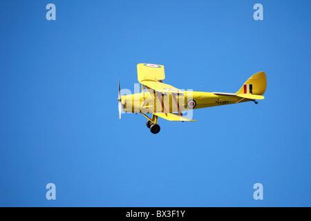 Chipmunk T 7281 in Flight _ De Havilland DH.82A Tiger Moth, G-ARTL / T7281, Private yellow bi-plane, UK - Stock Photo