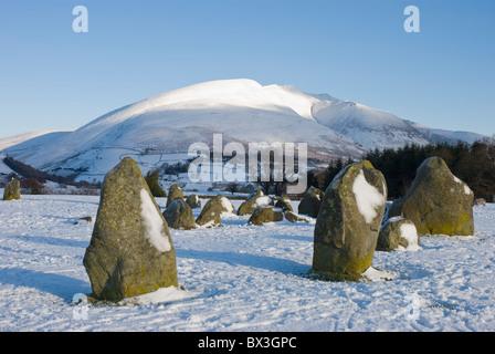 Castlerigg Stone Circle in the snow, with Blencathra, also known as Saddleback, Keswick, Cumbria - Stock Photo