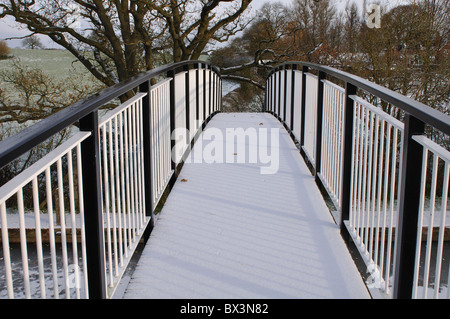 Footbridge over Grand Union Canal with snow on - Stock Photo