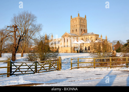 Tewkesbury Abbey in Gloucestershire is captured in the snow on a glorious winter morning in 2010. - Stock Photo