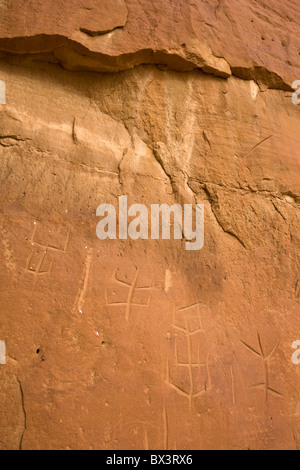 Incised petroglyphs along the petroglyph trail at The Chaco Culture National Historic Site in Chaco Canyon, New - Stock Photo