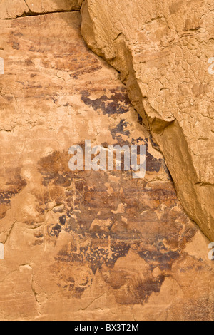 Petroglyph panel along the petroglyph trail at The Chaco Culture National Historic Site in Chaco Canyon, New Mexico. - Stock Photo