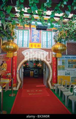 The Po Lin Monastery is located in Ngong Ping on Lantau Island in Hong Kong. Entrance to food hall - Stock Photo