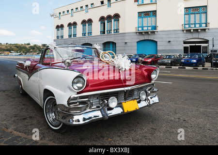 Cuban Wedding Car Outside The Plaza De San Francisco; Havana, Cuba - Stock Photo