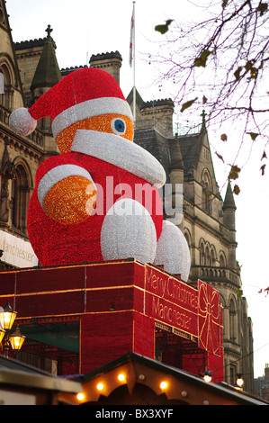Giant Santa Claus on display at Manchester Christmas Market - Stock Photo