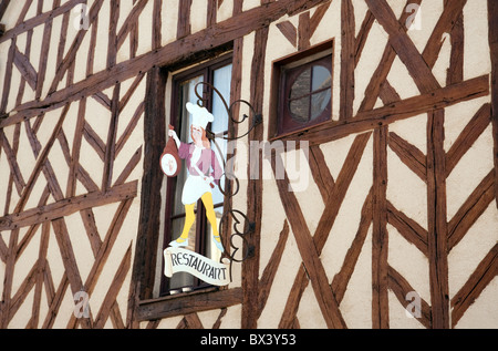 Restaurant sign on a half timbered medieval building, Provins, Seine et Marne, Ile de France, France - Stock Photo