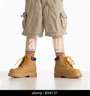 A Boy Wearing Work Boots - Stock Photo