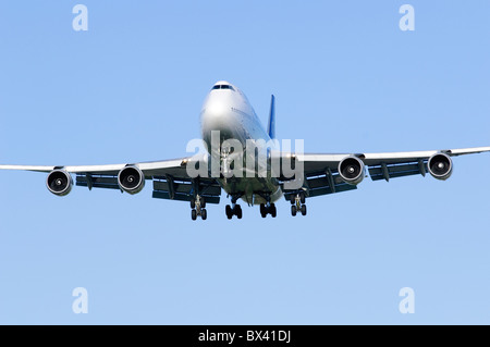 Boeing 747 Jumbo Jet operated Thai Airways on approach for landing at London Heathrow Airport - Stock Photo